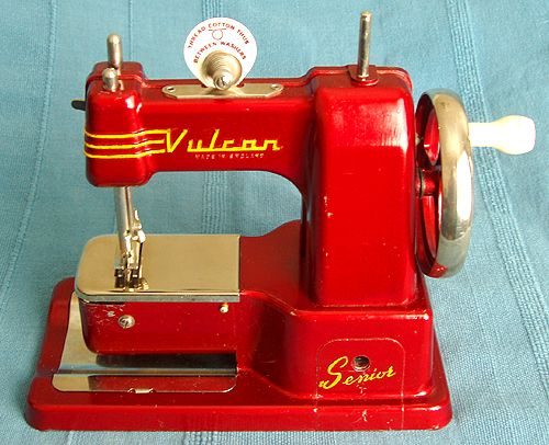 Vulcan Senior This appears to have been the top of the range Vulcan with detatchable cloth plate to turn the machine into a free arm machine. The table clamp slots into the hole on the base which prevented damage to the paintwork.