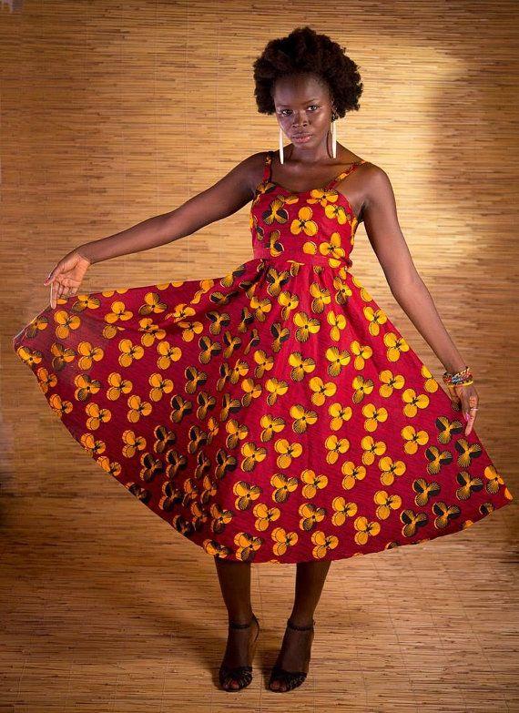 Ultra féminine en Wax sweetheart robe midi en rouge profond avec impression de fleurs jaune vif.  Robe court un peu grande, s'il vous plaît vérifier le calibrage avant de passer votre commande.  En raison de la nature à la main de la robe, s'il vous plaît attendre légères variations de la robe sur la photo dans cette liste.  Tissu : coton imprimé de cire 100 % Fabriqué en : Burkina Faso Prêt à lexpédition : Oui  TAILLE S (4/US6, UK10/UK12, EU36/38) Tour de poitrine : sadapte bu...