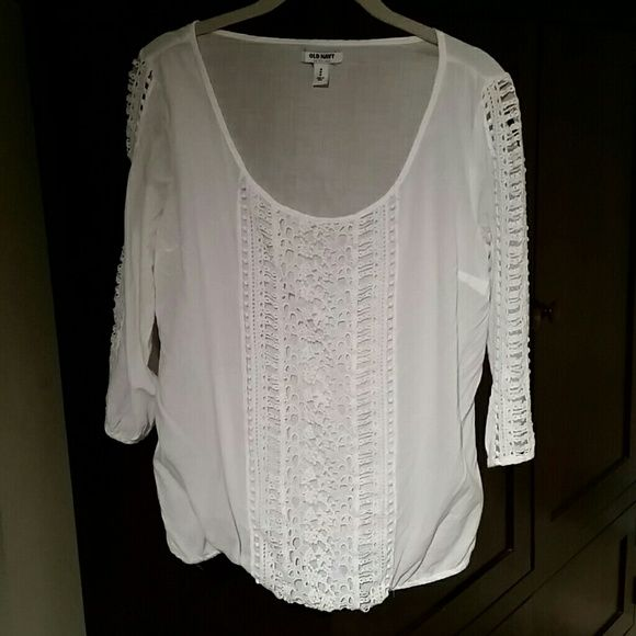 Beautiful sheer white shirt. This shirt is sheer material with 3/4 sleeves and lace panel that runs down the front and on sleeves.  Adorable on! Old Navy Tops