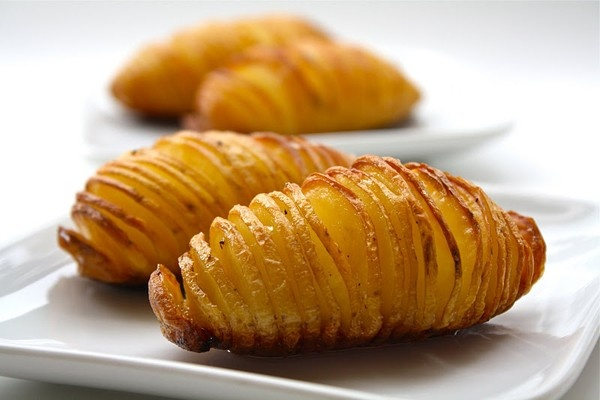 Better than fries! Cut potatoes almost all the way through, drizzle olive oil, butter, some sea salt, and pepper over top and bake @ 425 for 40 minutes. delicious