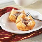 These easy mini pecan tarts feature puff pastry squares filled with brown sugar, butter and pecans. You might want to double the recipe...they're really good!