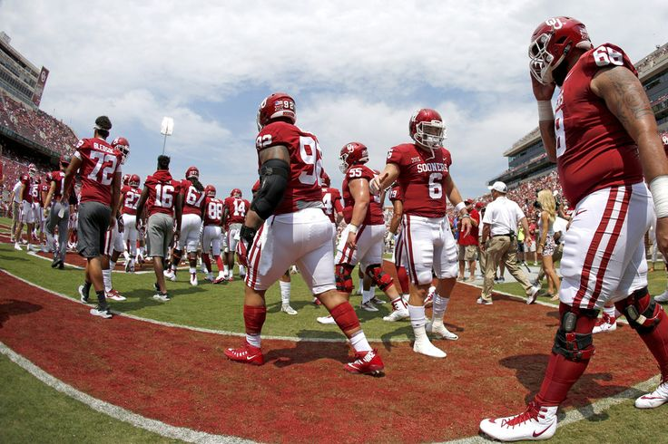 Oklahoma's Baker Mayfield greets teammates before a college football game between the Oklahoma Sooners (OU) and the University of Texas at El Paso Miners (UTEP) at Gaylord Family-Oklahoma Memorial Stadium in Norman, Okla., Saturday, Sept. 2, 2017. Photo by Bryan Terry, The Oklahoman