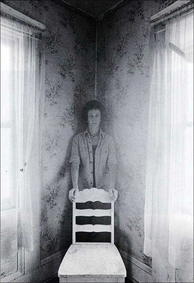 Eva Rubinstein (born 1933)  Eva Rubinstein, Self-portrait behind a white chair.