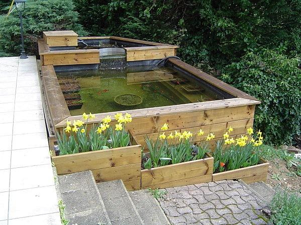 ... bassin : jardinières de fleurs de saison  Bassins de jardin
