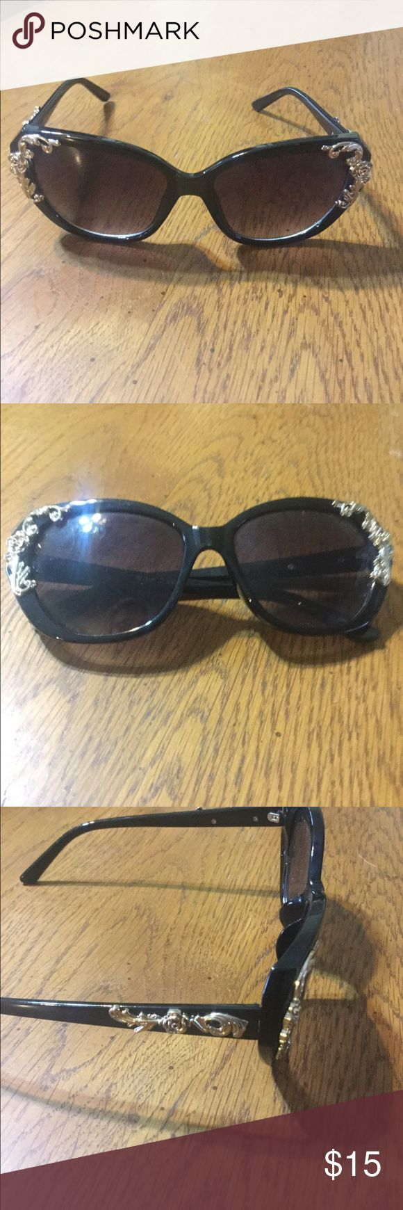 Black Betsy Johnson sunglasses with gold accents Black Betsy Johnson sunglasses with gold accents. The gold accents are roses they are on each side of the glass and as well on them stem. In great condition. They have an Old Hollywood movie star feel. Betsey Johnson Accessories Sunglasses