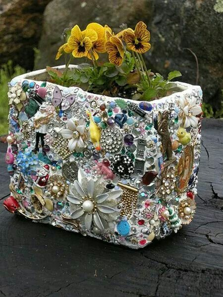 Mosaic planter made from old jewelry and broken china using a terracotta pot, liquid nails and grout