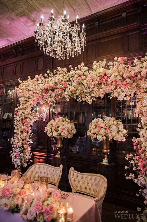 WedLuxe – A Castle Wedding with a Cherry Blossom-Adorned Sweetheart Table | Photography by: Lisa Mark Photography Follow @WedLuxe for more wedding inspiration!