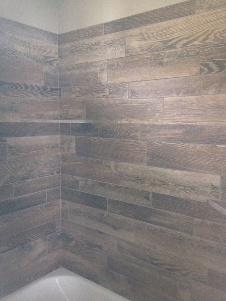 bathroom tub surround   wood tile turned  gorgeous   unique  bath