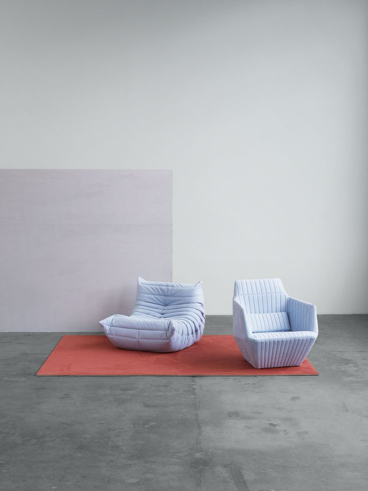 Ligne Roset armchair, Facett and Togo in upholstery textile Waterborn. Waterborn is a groundbreaking sustainable microfibre textile designed by Aggebo & Henriksen, which makes much less of an impact on the environment than conventionally produced microfibre fabrics.