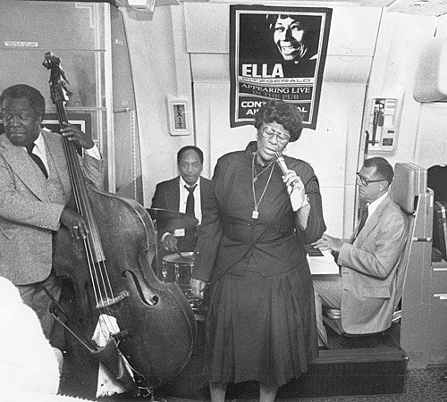 Keter Betts, left, Bobby Durham and Paul Smith backup Ella Fitzgerald in a performance at 35,000 feet during an airline flight.