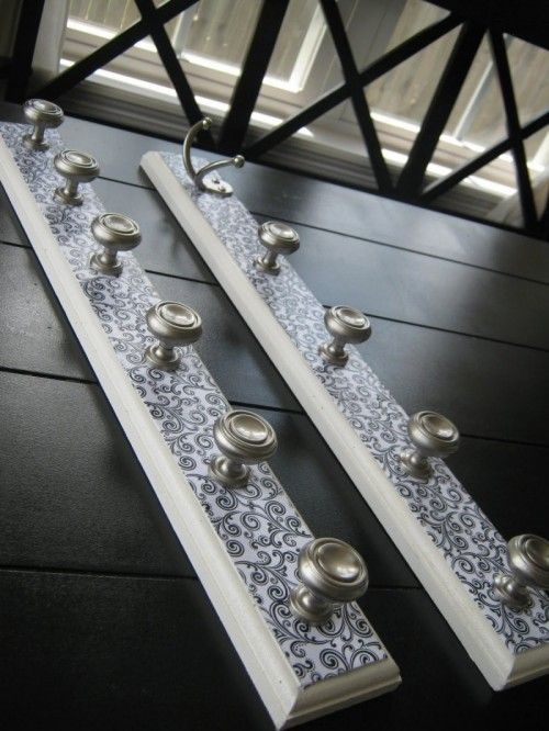 Jewlery Holders to hang on the wall..  Did this for girls room.  Hung one above another - top one for necklaces and bracelets and bottom one for sweaters and robes.  They love it!