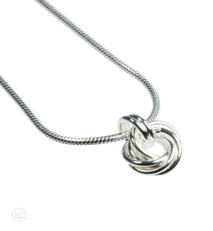 Rosabella Love Knot - Necklace – Rosabella Love Knot - Necklace – Simple and elegant express of love. This modest and unassuming necklace is the perfect piece for the every day, wear it with that little black dress or jean and a t-shirt. Each ring was hand coiled, cut and intertwined to create this perfect token of love which hangs from a discreet snake chain and is available in either 14kt Gold Filled or Sterling Silver. Pair it with the Rosabella Love Knot Earrings or Bracelet for that…