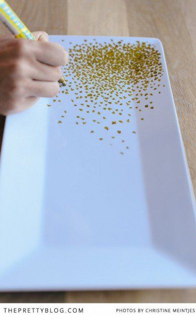 I have a brilliant idea: First, you either get glitter or a silver/bronze/gold marker and put dots on a nice, plain china plate and put little flowers all over the plate=awesome center peice!