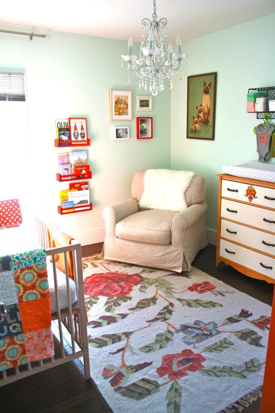 Minty turquoise girl's nursery with vintage flair.