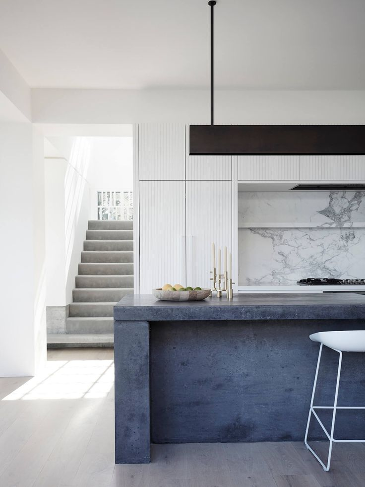The blue-black of this counter is simply stunning | Clovelly House by Madeleine Blanchfield Architects