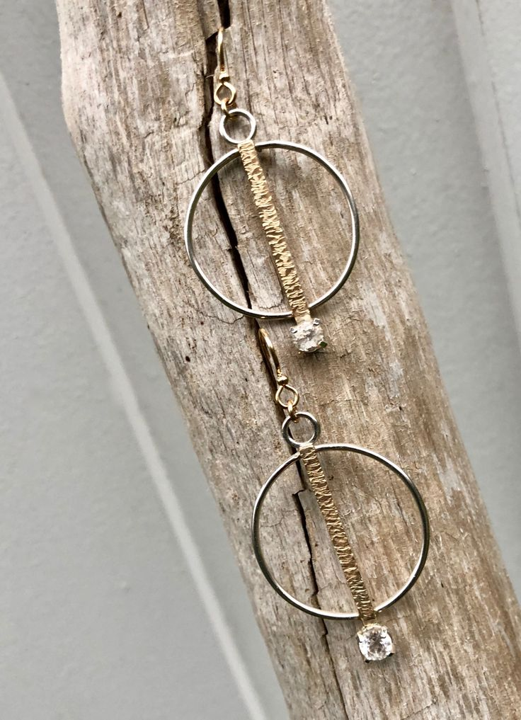 """""""If you got it, flaunt it!"""" $250 Be true to you.  Earrings shape the face.  I love mixing metals 14KTY with sterling silver that balance each other and then add a white Topaz gemstone for that simple pleasure."""