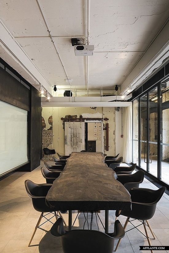 not only am i a sucker for reclaimed wood but i love that they seem to have a projector over the table.