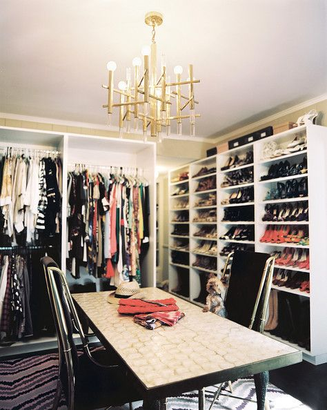 Lit in Luxury Chandeliers need not be restricted to grand rooms; a high-ceilinged closet gets a luxe upgrade with a fabulous fixture that warms up a cool-toned space.