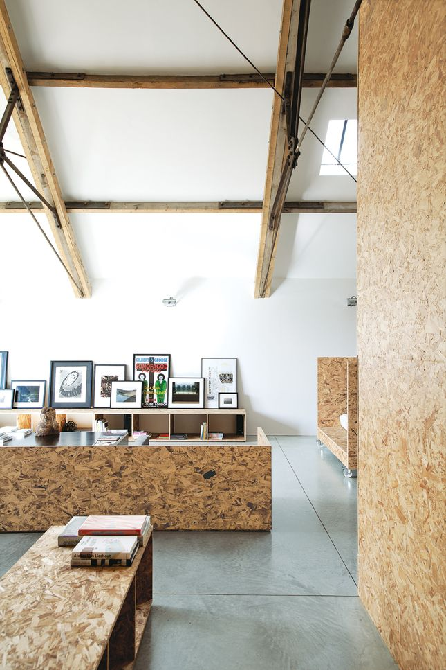 The combination of exposed wooden beams and white/OSB walls