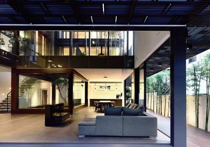A courtyard on two levels sits in the centre of this semi-detached house. On the first level, a frangipani tree sits in the middle of a pond, framed by a timber-clad box. The double volume living room and the dining room wraps around this courtyard. The second storey level of the courtyard lies over the …