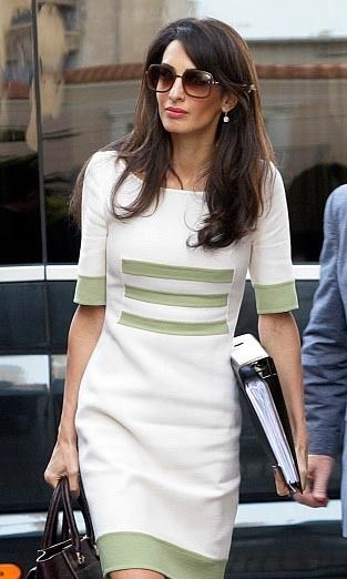 Armed with her bag, sunglasses and Camillo Bona dress, Amal headed into a meeting in Athens, Greece