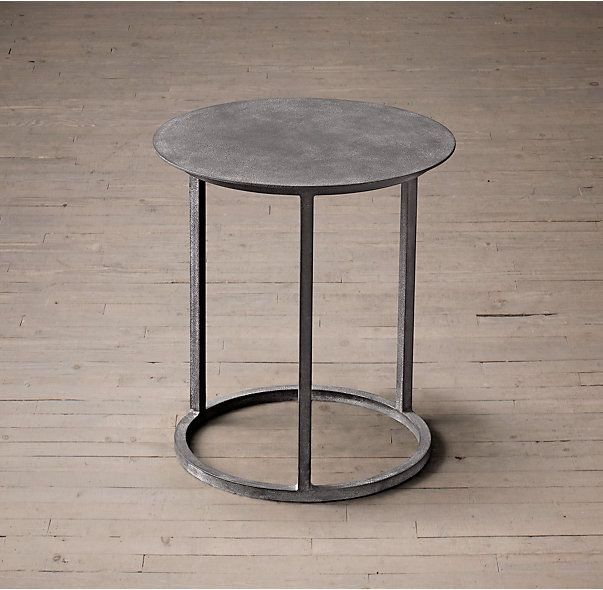 RH's Mercer Round Side Table:A design from the late 20th century, our Modernist metal table has the pared-down aesthetic of the industrial original. Built entirely of metal, it has a silhouette ring base that echoes the shape of the circular disc top.