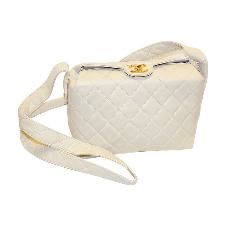 Chanel Creme lambskin quilted  shoulder bag | From a collection of rare vintage shoulder bags at https://www.1stdibs.com/fashion/handbags-purses-bags/shoulder-bags/