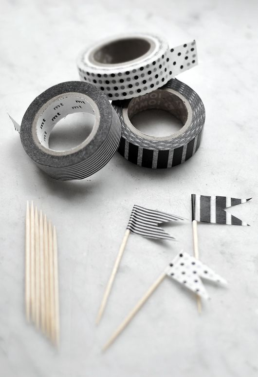 How easy is this: Buy patterned tape and wrap a strip of it around a toothpick and cut to make an easy (and adorable) topper for #cupcakes, #appetizers, etc.