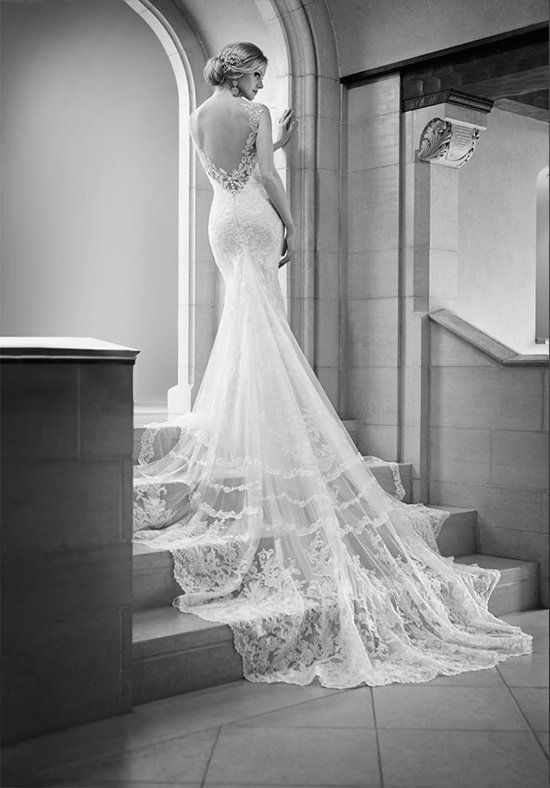 Style 675 by Martina Liana. This lace over Lustre Satin fit-and-flare designer bridal gown  features a low sweetheart neckline, Lace illusion back, scalloped Lace hem, and a stunning cathedral train. l TheKnot.com