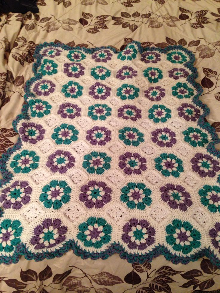 Here's my completed blanket. As long as you don't look too close, or wash it, it looks great!