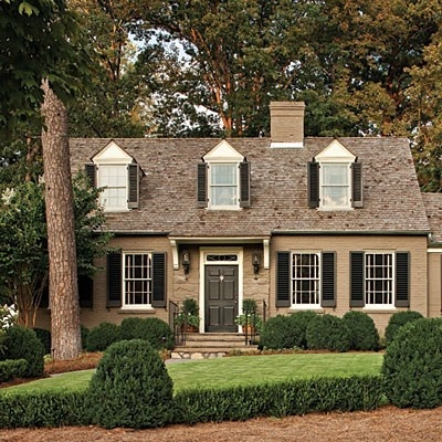 Welcoming exterior paint dormer windows black shutters and lush landscaping robyn porter for Porter exterior paint