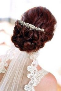 Wedding hair with bling and veil! I like how the veil goes under the hair, so as not to hide the 'do.