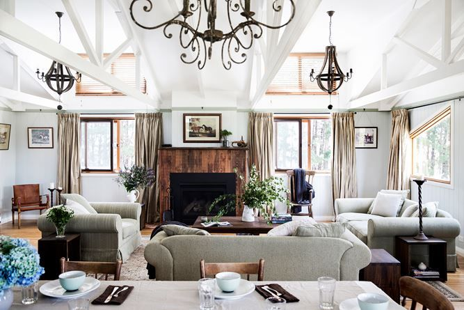 """Exposed rafters are a reminder of the home's origins – the timber chandeliers from [OneWorld Collection](http://www.oneworldcollection.com.au/?utm_campaign=supplier/