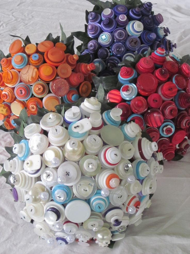 Bridal Button bouquet party. Bridesmaids orange, purple and red all with hints of aqua. Bride- white cream ivory, pearls with aqua and hints of bridesmaids colours