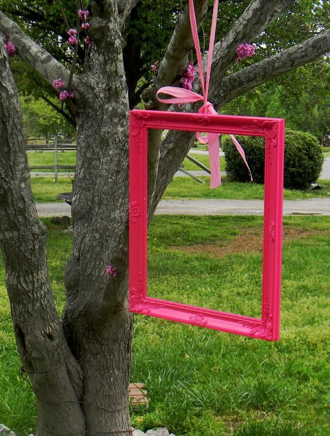 Hang different size & color picture frames for guest photos