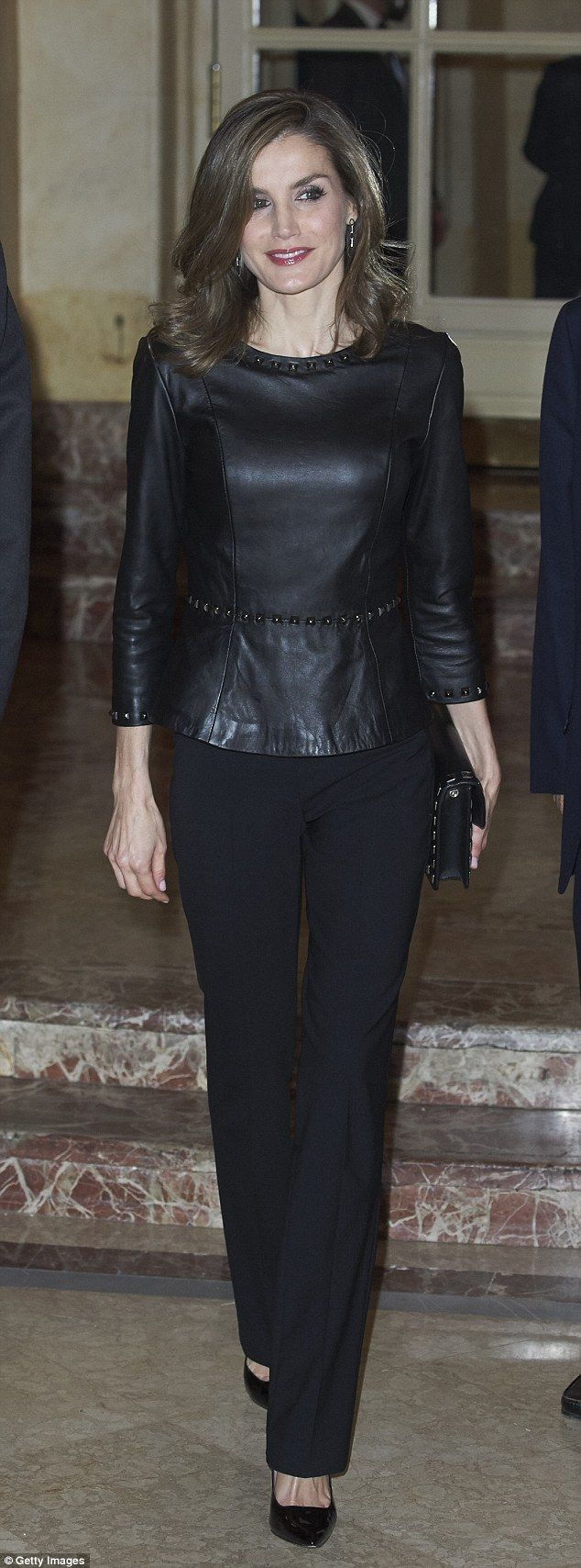 Queen Letizia of Spain, 44, showed off her more edgy side in a studded black leather peplu...