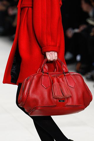 Burberry [love the bag. would like it better against a black coat, not another (clashing) red. jh]