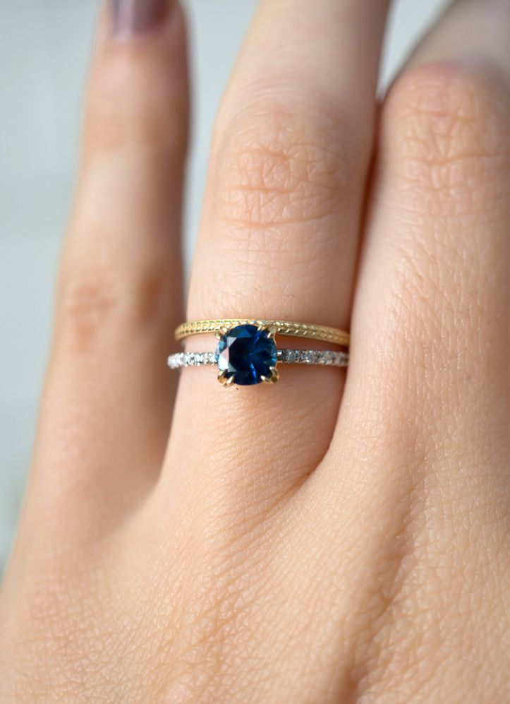 3b9802a67 This two tone ring design harmoniously 'marries' white and yellow gold,  complementing the beautiful deep blue color of the Montana Sapphire.