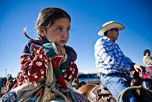 A girl waits for the parade to start at the Crow Fair pow wow in Crow Agency, Mont. (Photo by Adam Sings In The Timber)