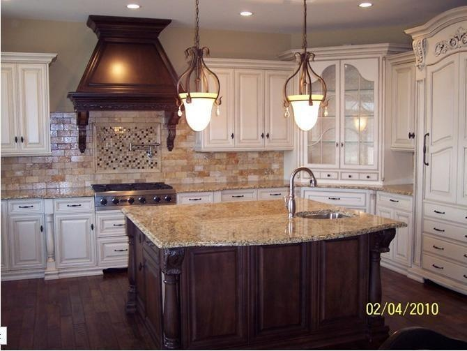 White Cabinets And Travertine Backsplash