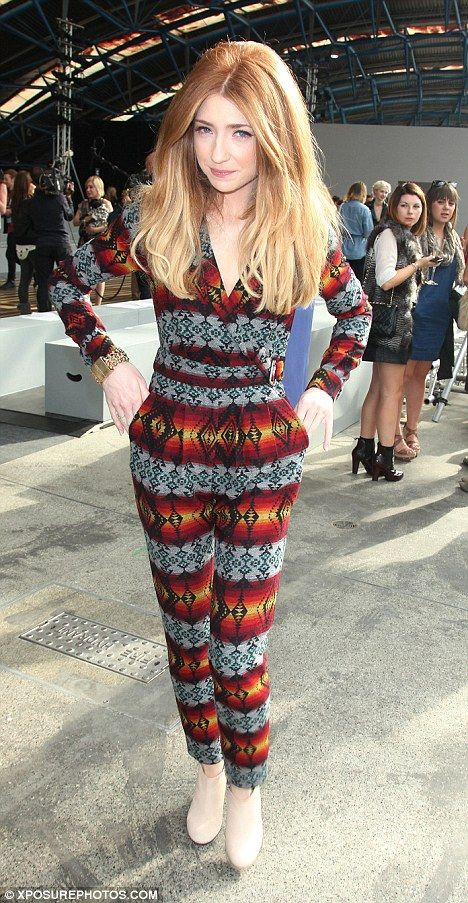 Nicola Roberts---the hair, not the hideous one piece!