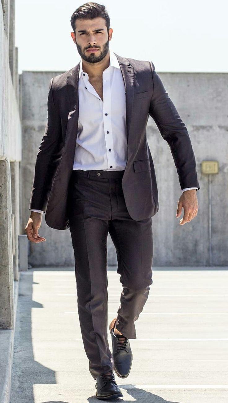 Hair, beard, suit and shirt.