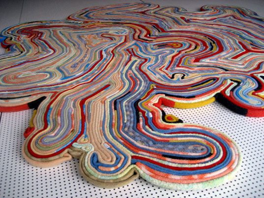This beautiful rug is made out of recycled blankets by Dutch designers Tejo Remy and Rene VeenHuizen. Looks like you can make a less complicated DIY version, using this and the recycled magazine bo...