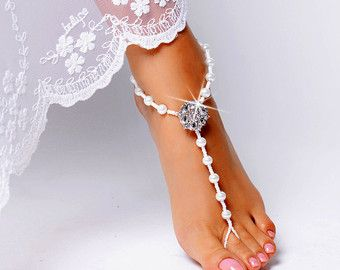 Stunning Barefoot Sandals Foot Jewelry. These will be an amazing addition to your beach wedding. Perfect for walking in the sand or dipping your toes in the water. A perfect finishing touch to your tropical beach wedding. I use the smallest seed beads around the toe area, you will not realize you are wearing them. Can also be worn with your own sandals. This listing is for 1 PAIR of pearl barefoot sandals. Please feel free to contact for questions and requests.  I can do discount on bulk…