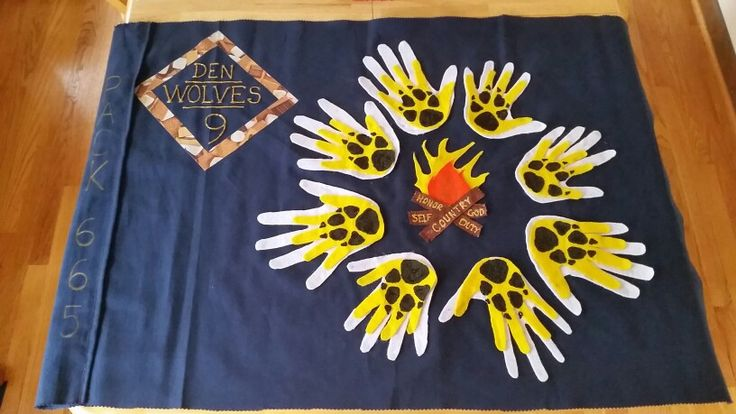 """Finally finished our den flag =o) AKELAS in white, WOLF CUBS in yellow. Inside flame: """"do our best"""" Maryland Pack 665, Den 9"""