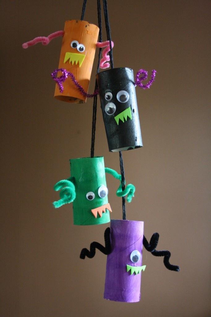 Hooligans! (craft) [toilet paper rolls, yarn, pipe cleaner, googly eyes, paper teeth, paint/markers]