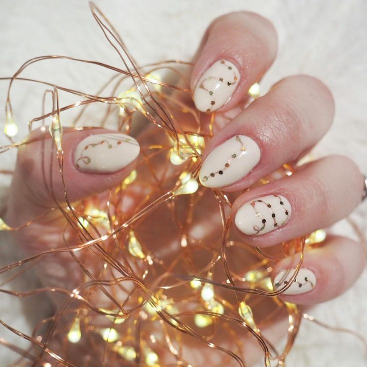 Twinkle light manicure for holiday. Done by Elyse Connery at Holden Grace in Toronto.
