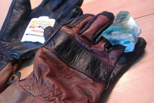 Treating Hestra Fält Guide gloves with balm by PropTP, via Flickr