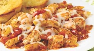 Italian Herb Baked Chicken and Pasta: Unlike most baked pasta recipes, this one starts with uncooked pasta so it's super convenient. With the added water and canned diced tomatoes, the pasta cooks in the oven along with the chicken and cheese for an easy one-dish meal.