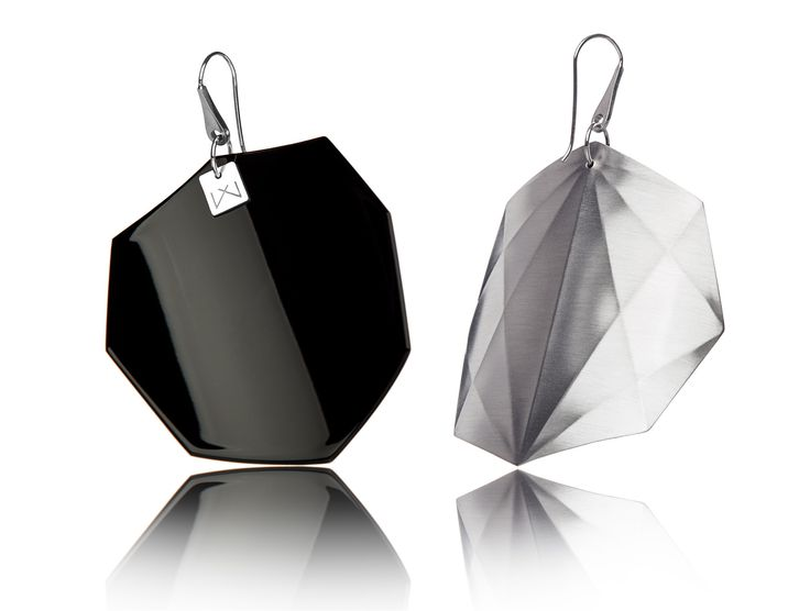 BLACK-OCTAGON-RHODIUM  Hanger: 925 STERLING silver with rhodium flashing.   Front part: colored, high gloss homogenous surface, UV-resistant.   Back part:  satin effect metal surface, rhodium coating (platinum flashing) in 3 layers.   Gloss preserving, wear-proof, oxidation resistant and anti-allergenic.  Available in three sizes: with a diameter of 4, 5 and 6 cms.